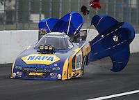 Feb 7, 2015; Pomona, CA, USA; NHRA funny car driver Ron Capps during qualifying for the Winternationals at Auto Club Raceway at Pomona. Mandatory Credit: Mark J. Rebilas-