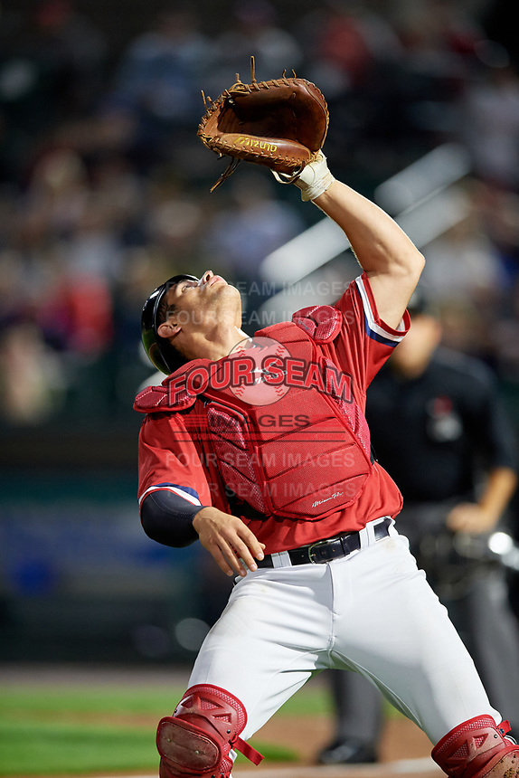 Rochester Red Wings catcher Anthony Recker (30) gets under a foul ball popup during the first game of a doubleheader against the Scranton/Wilkes-Barre RailRiders on August 23, 2017 at Frontier Field in Rochester, New York.  Rochester defeated Scranton 5-4 in a game that was originally started on August 22nd but postponed due to inclement weather.  (Mike Janes/Four Seam Images)