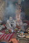 A Naga Sadhu (naked saint) sitting in his tent at Kumbh mela on 13th February 2010. Haridwar, Uttara Khand, India, Arindam Mukherjee