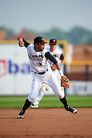 Quad Cities River Bandits shortstop Kristian Trompiz (3) throws to first during a game against the Bowling Green Hot Rods on July 24, 2016 at Modern Woodmen Park in Davenport, Iowa.  Quad Cities defeated Bowling Green 6-5.  (Mike Janes/Four Seam Images)