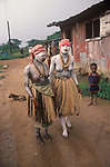 Monrovia, Liberia, West Africa 1983. Initiation ceremony teenage girls ritual coming of age painted in traditional white body paint. These girls were at a Grebo Bush school, and would be taking part in an initiation ceremony know as 'sande'. This was a woman's secret society, in Liberia and initiated girls into womanhood; female circumcision which was and still is in some parts believed to instil notions of morality and proper sexual comportment. The society maintains an interest in the well-being of its members throughout their lives.