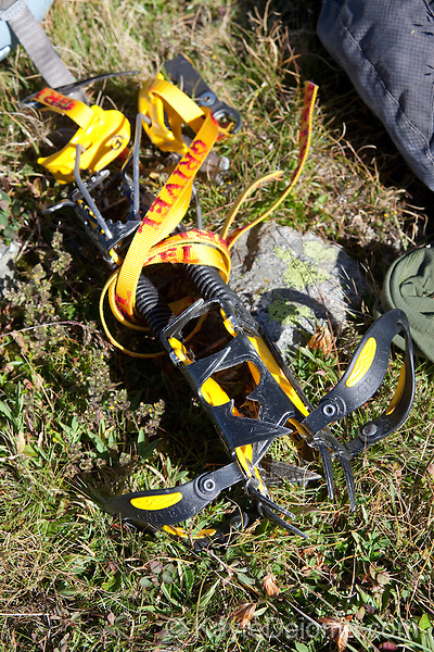 Crampons in the grass on the Plan D'Aiguille, midway up the mountain from Chamonix to the Aiguille du Midi, Chamonix-Mont-Blanc, France