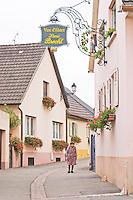 wrought iron sign old woman henri brecht eguisheim alsace france