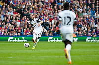 Sun 22 September 2013<br /> <br /> Pictured: Chico Flores of Swansea passes the ball to Nathan Dyer of Swansea<br /> <br /> Re: Barclays Premier League Crystal Palace FC  v Swansea City FC  at Selhurst Park, London