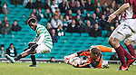 Celtic's Ibrahim Rabiu fails to take the ball past Arbroath keeper Scott Morrison but retains his balance without going down