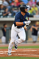 Left fielder Tim Tebow (15) of the Columbia Fireflies runs out a single in the second inning of a game against the Lexington Legends on Friday, April 21, 2017, at Spirit Communications Park in Columbia, South Carolina. Tebow went 3-for-3 with a walk and Columbia won, 5-0. (Tom Priddy/Four Seam Images)
