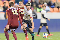 Houston, TX - Friday December 9, 2016: Ian Harkes (16) of the Wake Forest Demon Deacons passes the ball against the Denver Pioneers at the NCAA Men's Soccer Semifinals at BBVA Compass Stadium in Houston Texas.