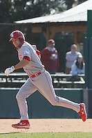 Drew Poulk of the North Carolina State Wolfpack running to second base during  a game against  the Coastal Carolina University Chanticleers at the Baseball at the Beach Tournament held at BB&T Coastal Field in Myrtle Beach, SC on February 28, 2010.