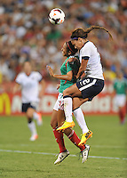 Sydney Leroux (2) of the USWNT heads the ball against Bianca Sierra (3) of Mexico. The USWNT defeated Mexico 7-0 during an international friendly, at RFK Stadium, Tuesday September 3, 2013.