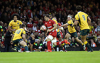 Pictured: Sam Warburton of Wales (with ball) is about to get stopped by Bernard Foley (10) of Australia. Saturday 08 November 2014<br />
