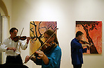 """(left to right) Richard Blayden <cq>, on violin, Gina Zagni <cq>, on viola, and Paul Robson <cq>, on second violin, warm-up Saturday, July 28, 2007, at the Museum of Florida Art in DeLand. Members of the London Symphony Orchestra were joined by an animateur to lead youngsters age three to eight in a storybook-style exploration of musical instruments. Two different programs were offered, each one running about an hour in length. This program was """"The Lion Who Wanted to Love."""" In the jungle, the lion cub just could not make friends with any of the other animals.  But this did not stop him from helping any others he found in trouble.  His kindness eventually helped save his own skin. (Daytona Beach News-Journal, Chad Pilster)"""