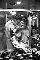 """France. Saône-et-Loire department. Chalon-sur-Saône. Kodak factory. Camera recycling. Fun Mini, 35 mm camra with film.Three workers control the packaging of new cameras ready to be sent out for sale. The """"ready to take pictures"""" camera is a small camera commonly described as disposable but in fact assembled for customers to return it after use. After being dismantled, verified and meticulously cleaned, some pieces are reused, other recycled (86%). The plastics parts are torn, melted, recasted and then reassembled. Eastman Kodak Company. Chalon-sur-Saône is located in the south of the Burgundy region. © 1996 Didier Ruef .."""