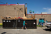 """Members work outside of the Friendship Westside Center for Excellence during """"Circle the City with Service,"""" the Kiwanis Circle K International's 2015 Large Scale Service Project, on Wednesday, June 24, 2015, in Indianapolis. (Photo by James Brosher)"""
