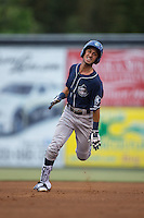 Carlos Herrera (4) of the Asheville Tourists legs out a triple in the top of the second inning against the Kannapolis Intimidators at Intimidators Stadium on May 28, 2016 in Kannapolis, North Carolina.  The Intimidators defeated the Tourists 5-4 in 10 innings.  (Brian Westerholt/Four Seam Images)