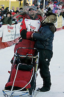 Tuesday March 13, 2007   ----   Lance Mackey, the 2007 Iditarod champion hugs his brother Jason as he arrives in Nome.