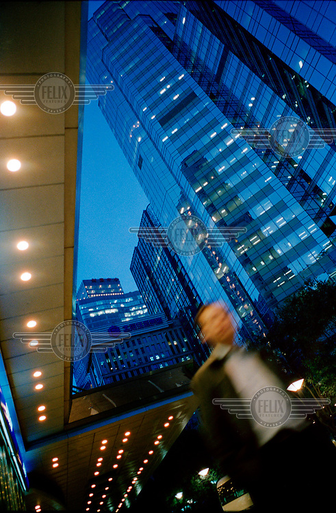 An office worker returns home after a day at work in the Central Business District (CBD).