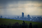© Joel Goodman - 07973 332324 . 20/02/2014 . Manchester , UK . Landscape view across Manchester taken from Saddleworth near Oldham , featuring the city's iconic Beetham Tower in the centre and the Piccadilly Tower and Town Hall  to its right . Photo credit : Joel Goodman
