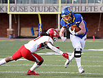 BROOKINGS, SD - MARCH 13: Zach Heins #87 of the South Dakota State Jackrabbits tries to avoid the tackle of Zaire Jones #1 of the Youngstown State Penguins at Dana J. Dykhouse Stadium on March 13, 2021 in Brookings, South Dakota. (Photo by Dave Eggen/Inertia)