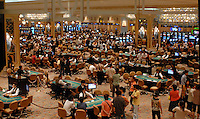 Gamblers in the newly opened Venetian Casino and Resort in Macau, 30 August 2007. Macau has re-modelled itelf as a gambling mecca and pulls in more money than Las Vegas.<br /> <br /> PHOTO BY RICHARD JONES/SINOPIX
