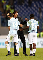 Calcio, Serie A: Roma, stadio Olimpico, 22 ottobre 2017.<br /> Lazio's coach Simone Inzaghi (c) celebrates with Lazio's Luis Alberto Romero (l) and Jacinto Quissanga Bastos (r) after winning 3-0 the Italian Serie A football match between Lazio and Cagliari at Rome's Olympic stadium, October 22, 2017.<br /> UPDATE IMAGES PRESS/Isabella Bonotto