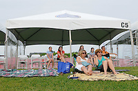 Fans watch from a cabana. FC Gold Pride defeated Sky Blue FC 1-0 during a Women's Professional Soccer (WPS) match at Yurcak Field in Piscataway, NJ, on May 1, 2010.