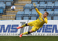 Charlton goalkeeper, Ben Amos, dives in vain and fails to stop Jordan Graham scoring Gillingham's first goal from the penalty spot during Gillingham vs Charlton Athletic, Sky Bet EFL League 1 Football at the MEMS Priestfield Stadium on 21st November 2020