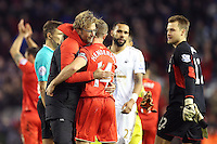 Liverpool Manager Jurgen Klopp hugs Jordan Henderson after the Barclays Premier League Match between Liverpool and Swansea City played at Anfield, Liverpool on 29th November 2015