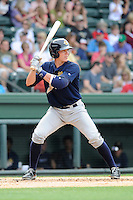 Catcher Peter O'Brien (9) of the Charleston RiverDogs bats in a game against the Greenville Drive on Sunday, May 19, 2013, at Fluor Field at the West End in Greenville, South Carolina. O'Brien was a second-round pick of the New York Yankees in the 2012 First-Year Player Draft. Charleston won, 9-7. (Tom Priddy/Four Seam Images)