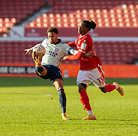 9th January 2021; City Ground, Nottinghamshire, Midlands, England; English FA Cup Football, Nottingham Forest versus Cardiff City; Josh Murphy of Cardiff City clears the ball as Gaetan Bong of Nottingham Forest comes in to tackle