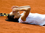 June 5, 2010.Francesca Schiavone of Italy, falls to the court after defeating Samantha Stosur of Australia, 6-4, 7-6 (2) in the final of the wormen's singles, at the French Open, played at Stade Roland Garros, Paris France