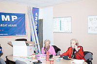 Martha Hunnewell, of Newport, Rhode Island, (right) and Diana Slaughter, of Birmingham, Alabama, work the phone bank at the campaign headquarters of Republican presidential candidate Donald Trump in Manchester, New Hampshire, on the day of the primary, Tues., Feb. 9, 2016. Donald Trump won the primary.