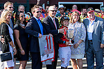 SARATOGA SPRINGS - AUGUST 27: Jockey Joe Bravo for A.P. Indian #11 (not pictured) poses for a photo with the connections after winning the Priority One Jets Forego Stakes on Travers Stakes Day at Saratoga Race Course on August 27, 2016 in Saratoga Springs, New York. (Photo by Sue Kawczynski/Eclipse Sportswire/Getty Images)