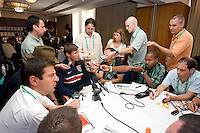 USA's Brian McBride gives interviews during a media mixed zone in Hamburg, Germany, for the 2006 World Cup, June, 9, 2006.