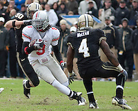 Ohio State wide receiver Duron Carter (#9) looks to avoid Purdue safety Dwight Mclean (#4). The Purdue Boilermakers defeated the Ohio State Buckeyes 26-18 at Ross-Ade Stadium, West Lafayette, Indiana on October 17, 2009..