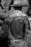 Contemporary slavery. Sugarcane cutters under debt-bondage at sugarcane Plant. State: Bahia, Brazil. Unhealthy conditions of work.