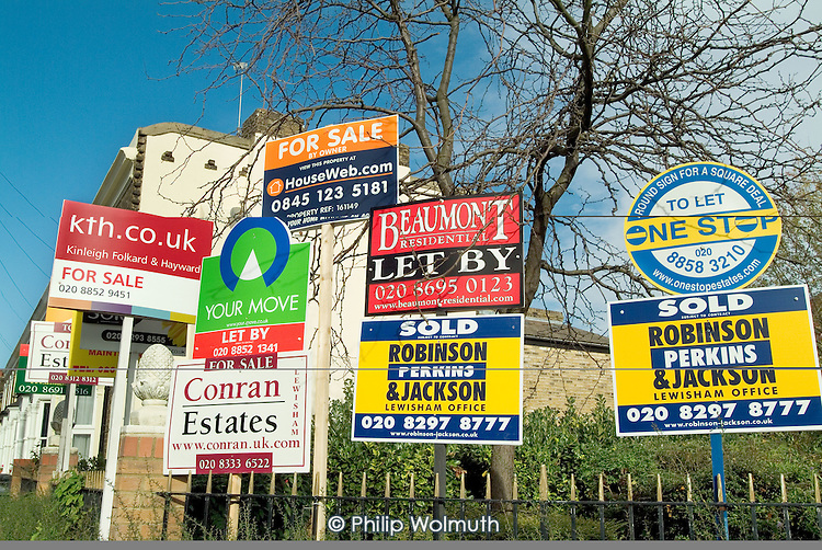 Estate agents' boards in Lewisham, London