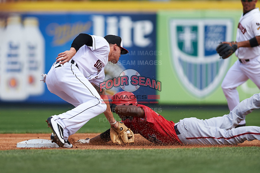 Erie Seawolves shortstop JaCoby Jones (12) tags Isaac Ballou (26) sliding into second during a game against the Harrisburg Senators on August 30, 2015 at Jerry Uht Park in Erie, Pennsylvania.  Harrisburg defeated Erie 4-3.  (Mike Janes/Four Seam Images)