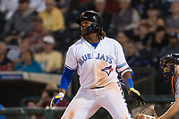 AFL West third baseman Vladimir Guerrero Jr. (27), of the Surprise Saguaros and Toronto Blue Jays organization, releases his bat as he starts down the first base line during the Arizona Fall League Fall Stars game at Surprise Stadium on November 3, 2018 in Surprise, Arizona. The AFL West defeated the AFL East 7-6 . (Zachary Lucy/Four Seam Images)