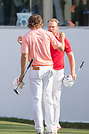 Peter Uihlein of USA (in pink) and Danny Willett of England (in red) shake hands at the end of the tournament during the 58th UBS Hong Kong Golf Open as part of the European Tour on 11 December 2016, at the Hong Kong Golf Club, Fanling, Hong Kong, China. Photo by Vivek Prakash / Power Sport Images