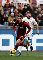 Football, Serie A: AS Roma - Torino, Olympic stadium, Rome, January 19, 2019. <br /> Roma's Nicolò Zaniolo (l) in action with Torino's Tomas Eduardo Rincon (r) during the Italian Serie A football match between AS Roma and Torino at Olympic stadium in Rome, on January 19, 2019.<br /> UPDATE IMAGES PRESS/Isabella Bonotto