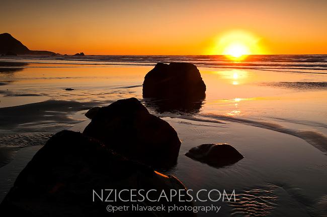 Sunset on the rugged coast and beaches in Punakaiki - Paparoa National Park, West Coast, New Zealand