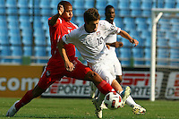 Kelyn Rowe (right) battles against Panama player. USA Men's Under 20 defeated Panama 2-0 at Estadio Mateo Flores in Guatemala City, Guatemala on April 2nd, 2011.