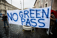 """Few """"no green pass"""" activists who, during the demo, were allegedly expelled. <br /> <br /> Rome, Italy. 11th October, 2021. Today, the Trade Unions: Cobas, Cub, Usb Lavoro Privato, Orsa, Sgb - supported by the Alitalia workers, state school and University precarious workers, GKN workers, students, and some extra-parliamentary lefty Parties - held a 24-hour General Strike to protest against the economic policies of the Italian Government led by Mario Draghi. The demonstration started in Piazza della Repubblica and ended in Via Dei Fori Imperiali."""