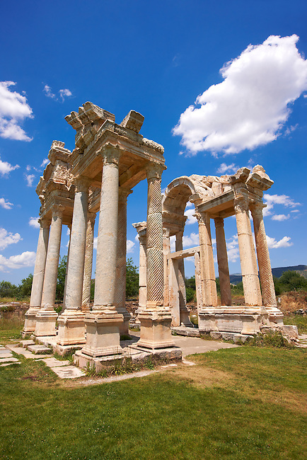 "Picture of the double Tetrapylon Gate 2, Aphrodisias, Turkey. A tetrapylon (Greek: Τετράπυλον, ""four gates"") is an ancient type of Roman monument of cubic shape, with a gate on each of the four sides: generally it was built on a crossroads. stock photos & photo art prints."
