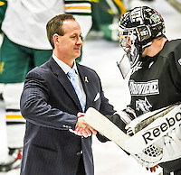 29 December 2014: University of Vermont Catamount Head Coach Kevin Sneddon, in his 12th season coaching the Men's Ice Hockey Team, congratulates Providence College Friars Goaltender Jon Gillies, a Junior from South Portland, Maine after the deciding game of the annual TD Bank-Sheraton Catamount Cup Tournament at Gutterson Fieldhouse in Burlington, Vermont. The Friars shut out the Catamounts 3-0 to win the 2014 Cup. Mandatory Credit: Ed Wolfstein Photo *** RAW (NEF) Image File Available ***