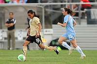 Marta (10) of FC Gold Pride plays the ball as head coach Albertin Montoya looks on. FC Gold Pride defeated Sky Blue FC 1-0 during a Women's Professional Soccer (WPS) match at Yurcak Field in Piscataway, NJ, on May 1, 2010.