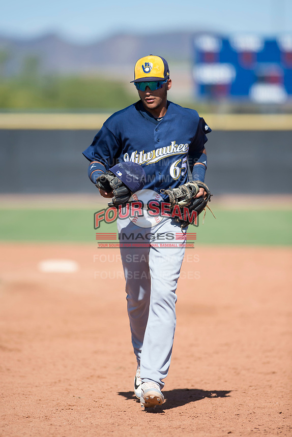 Milwaukee Brewers second baseman Daniel Castillo (65) jogs off the field between innings of an Instructional League game against the San Diego Padres at Peoria Sports Complex on September 21, 2018 in Peoria, Arizona. (Zachary Lucy/Four Seam Images)