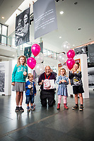 Tuesday 01 August 2017<br /> Pictured: Willow, Olivia, Rohan and Isaac from Birchgrove, Swansea help Head of Museum Steph Mastoris celebrate the 3,000,000th visitor to the museum. <br /> Re: National Waterfront Museum Swansea celebrate 3 Million visitors to the Museum.