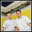 03/04/2009  Copyright Pic: James Stewart.File Name : sct_jspa05_mural.STEPHEN MATTHEWS AND SCOTT MCCABE (GLASSES) BESIDE THE MURAL DEPICTING SCENES FROM THE FORTH & CLYDE AND UNION CANALS, DATING BACK TO AROUND 1903, FOUND DURING RENOVATIONS AT THEIR COMPANY, PRINT CENTRAL, IN FALKIRK....  .James Stewart Photography 19 Carronlea Drive, Falkirk. FK2 8DN      Vat Reg No. 607 6932 25.Telephone      : +44 (0)1324 570291 .Mobile              : +44 (0)7721 416997.E-mail  :  jim@jspa.co.uk.If you require further information then contact Jim Stewart on any of the numbers above.........