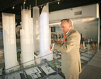 Tenth anniversary of 9/11.  Rebuilding at the World Trade Center site.  Developer and World Trade Center lease-holder, Larry A. Silverstein,   President and CEO of Silverstein Properties checks time.  Scale model shows L to R: 4 WTC, 3 WTC and 2 WTC, buildings which he controls.   Photo by Ari Mintz.  8/22/2011.